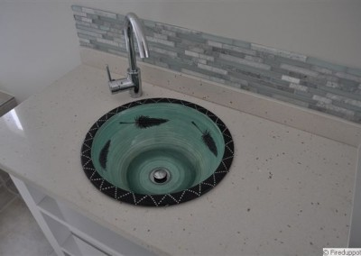 Aqua basin set in counter with mosaics