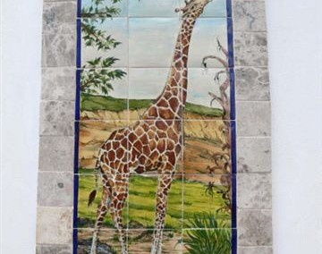 Giraffe framed with travertine